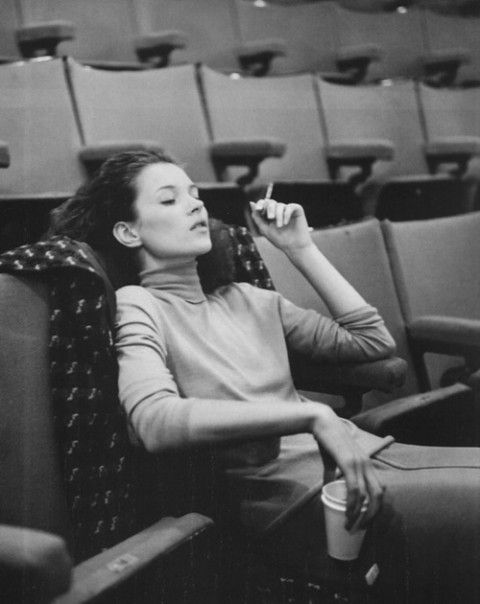 kate moss relaxing while attending a private screening of a johnny depp film back in the days.