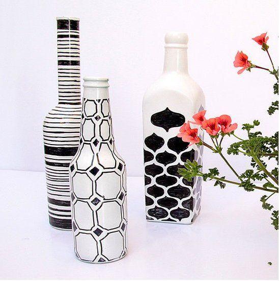 spray painted wine/beer bottles white, black sharpee geometric and fancy designs on top