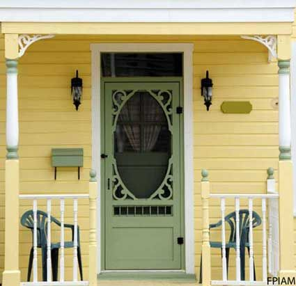 Vintage Style Wood Screen Door with a refreshing green and yellow color scheme. Front-Porch-Ideas-and-More.com #frontdoor