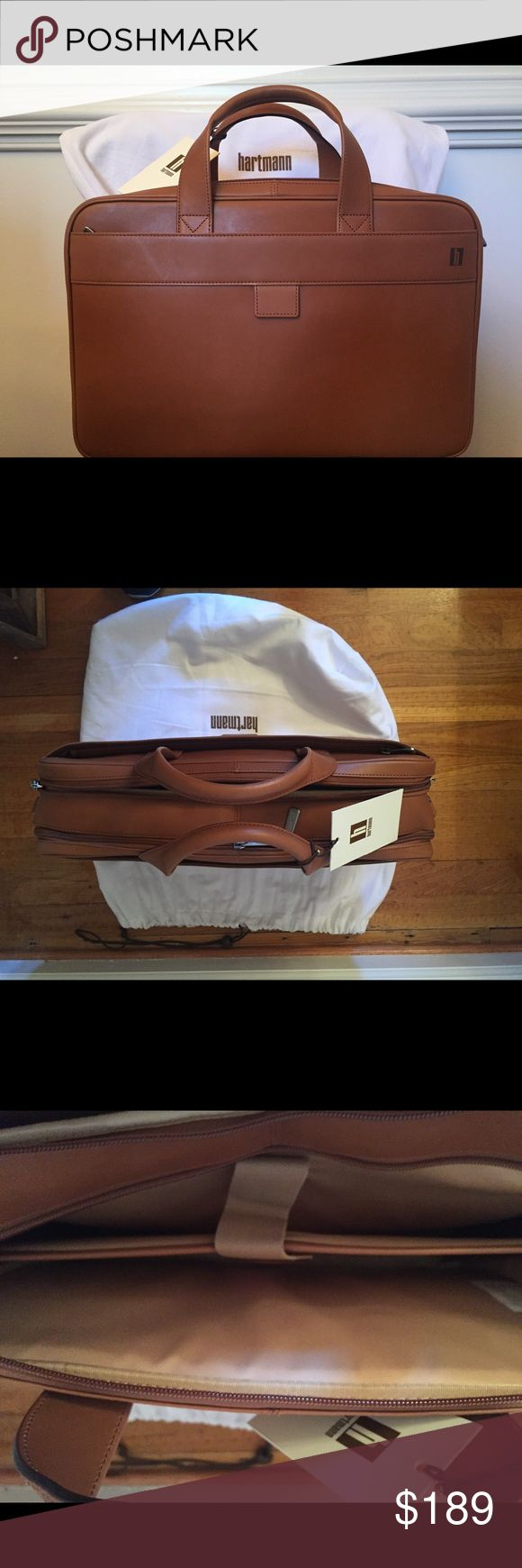 Hartmann Heritage Belting Leather Briefcase Beautiful full grain brown Hartmann belting leather double compartment brief case.  Leather handles and and adjustable shoulder strap.  Zippered companion strap slides into rolling suitcase handle for easy transport.  Padded computer area.  16.25x12.5x4.5 inches.  Bought for my husband but he never used it.  Retail price 425.00 Hartmann Bags Laptop Bags