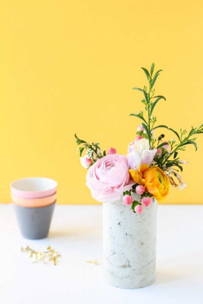 Brighten up your desk with fresh flowers in this concrete planter.