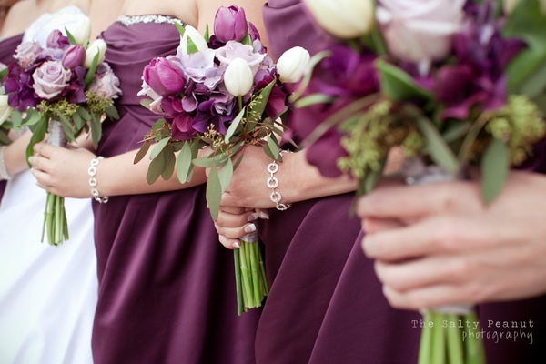 Plum wedding flowers and dress for the bridesmaids