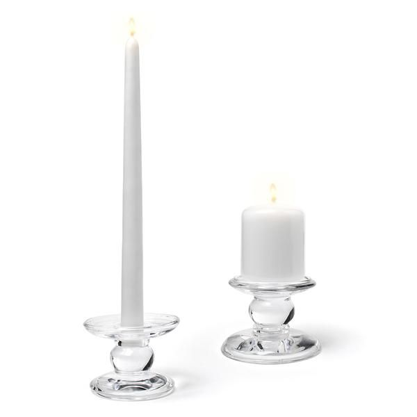 That's innovation! This elegant reversible glass candle holder can hold tapers on one side and pillars on the other. Flip to suit your needs!