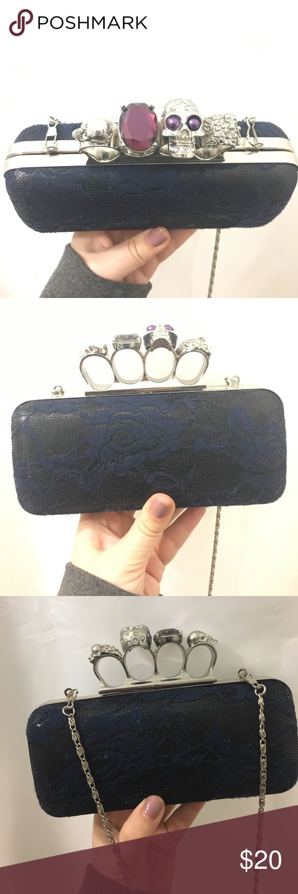 Patricia Field rock n roll knuckle bag Patricia field rock n roll knuckle bag- black bag with navy lace flowers- detachable chain- can be worn as a clutch or a side bag patricia fields Bags Clutches & Wristlets