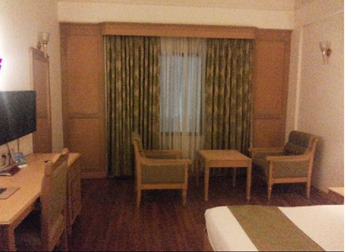 Clean And Simple Bed Room In Cochin Hotels