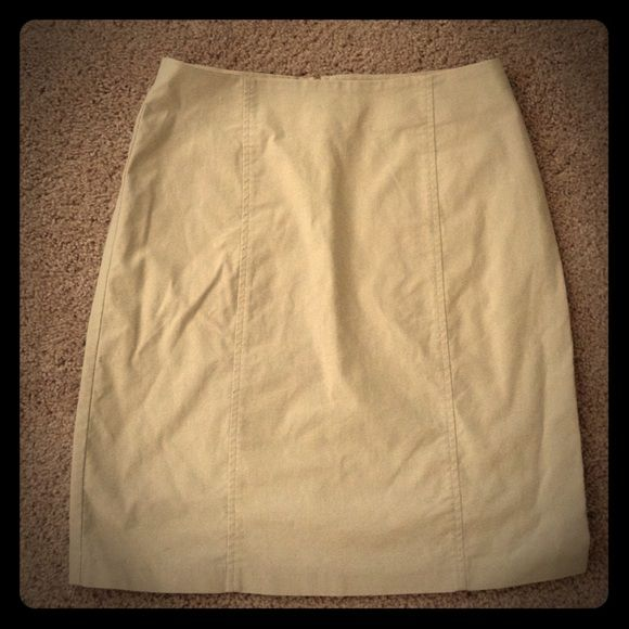 Khaki pencil skirt. Above knee. Like new Above knee stretchy khaki pencil skirt! never worn! Great for office wear! Brand tag missing Skirts Pencil