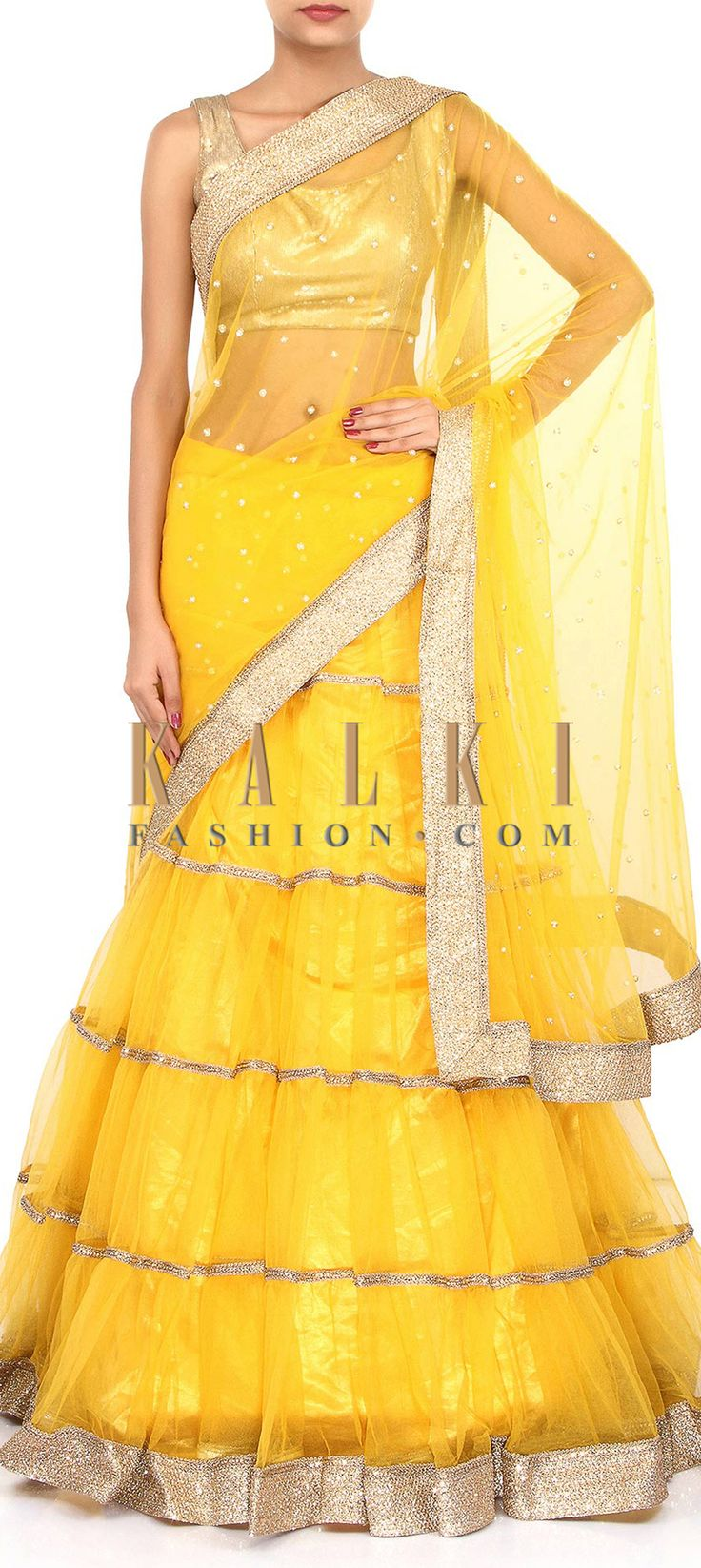 Buy Online from the link below. We ship worldwide (Free Shipping over US$100). Product SKU - 262211. Product Link - http://www.kalkifashion.com/yellow-lehenga-saree-embellished-in-sequin-and-pearl-border-only-on-kalki.html