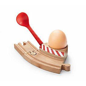 Holzkurve für das Frühstücksei samt integriertem roten Eierlöffel: Wie eine Schranke lässt sich der seitlich... - Eierbecher mit Schranke