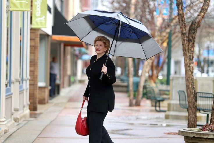 U.s. Senator Debbie Stabenow Of Michigan Walking Through The Rain