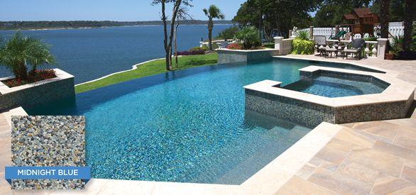 This infinity edge pool utilizes Crystal Stones Midnight Blue ...