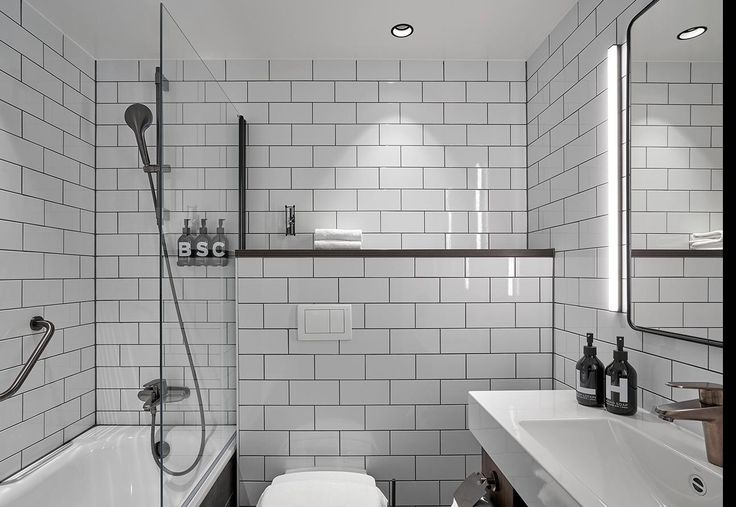 Hotellkänsla över badrum m sån här kakelsättning