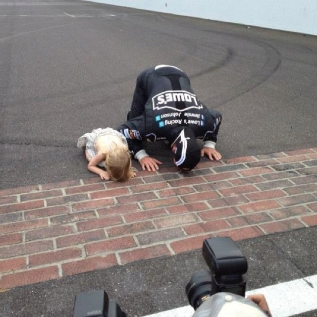 Sweet! JJ's daughter kissing the bricks with him at Indy.