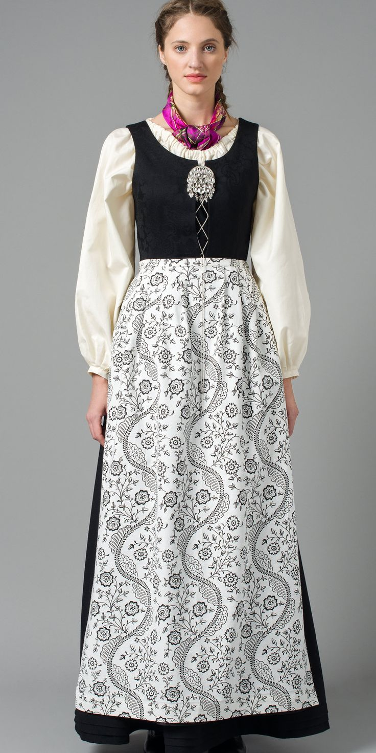 Northern Norway brunad with white shirt and black patterned apron