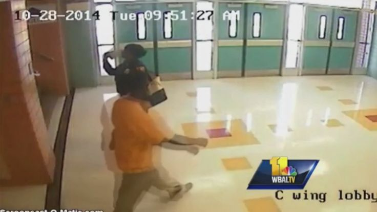 Surveillance footage from Vanguard Middle School in Baltimore shows a school police officer beating a 13-year-old girl with a baton during a scuffle involving two other students in October. All three girls were hospitalized with injuries they sustained from the officer, local NBC outlet WBAL reports.