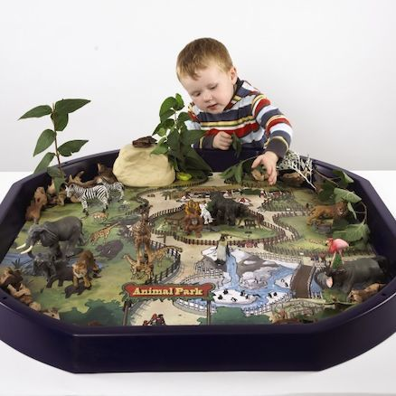 Active World Tuff Spot Tray - Animal Park Mat.  Enter the park and meet Elephants, Monkeys, Birds, Zebra and other animals from all over the world on this wipe clean PVC mat.  Simply place the mat in the Active World tray (builder's tray) and add materials for a realistic scene. Put ice cubes and water for the penguins or mini trees for the birds or giraffe to sit or feed upon. Whether using stones, fabric, leaves etc, a multi- sensory microcosm can be created. Size approx 86cm².