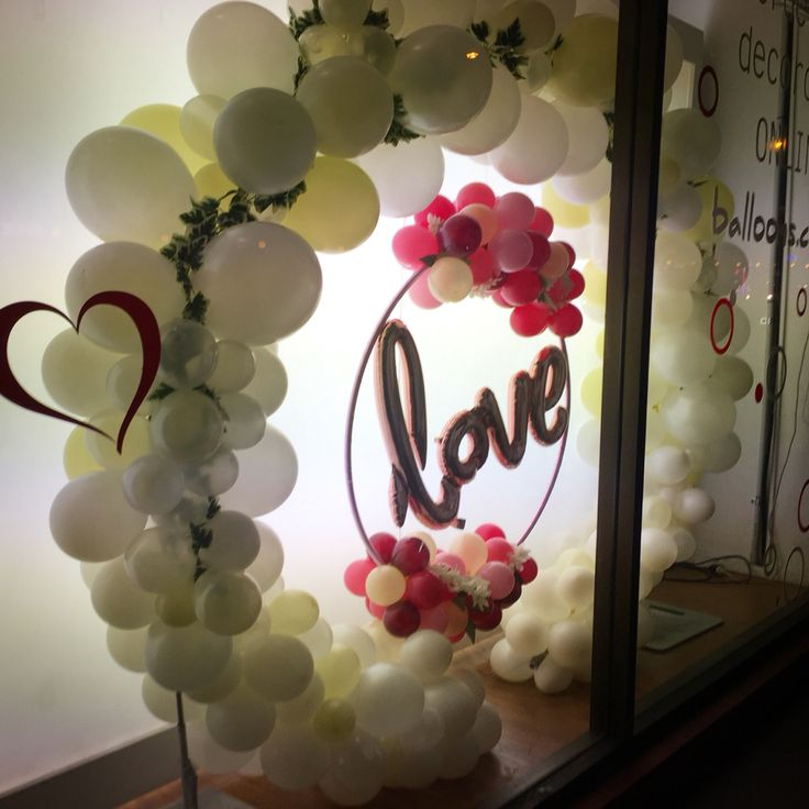 Balloon arbour with feature love hoop, with organic garlands of flower and greenery incorporated