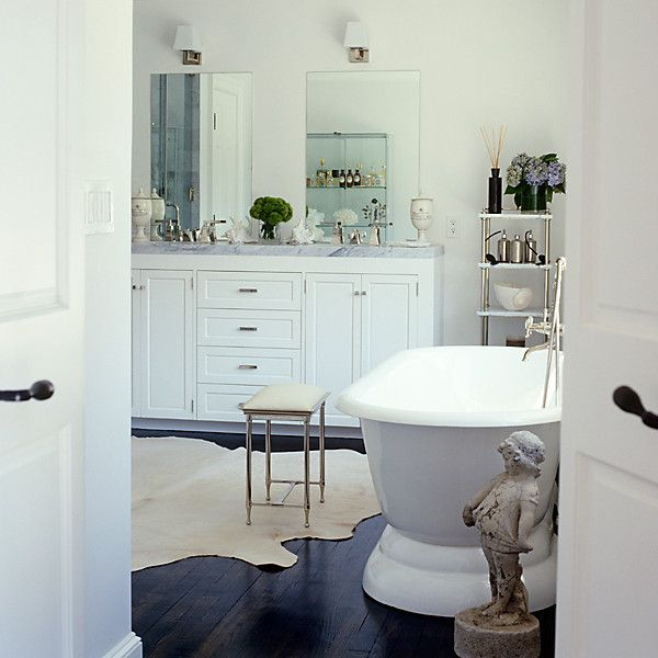 Dark-brown floors look luxe in bathrooms, but need white walls and furnishings to balance them out.