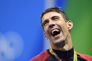 Michael Phelps laughs after bagging his 19th Olympic gold medal.