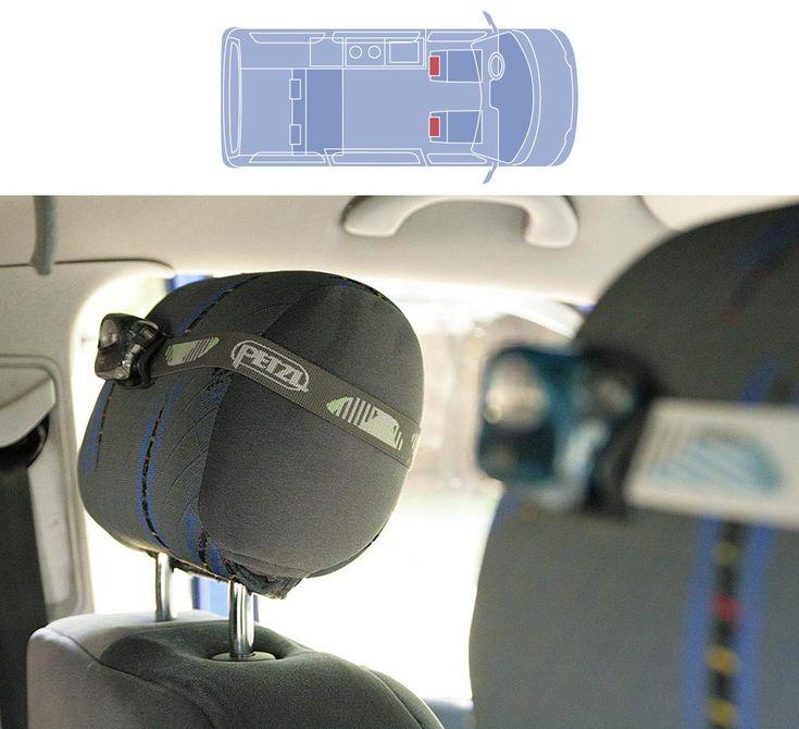 Los reposacabezas de una furgoneta sirven de soporte para unas linternas frontales