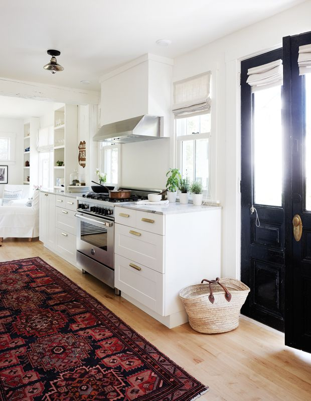 all white kitchen with boho rug