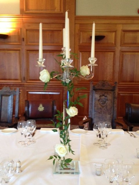 Candelabra with foliage and roses www.flowers4weddings.com