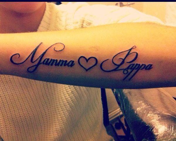 A mum and dad tattoo but it is on swedish mamma och pappa.