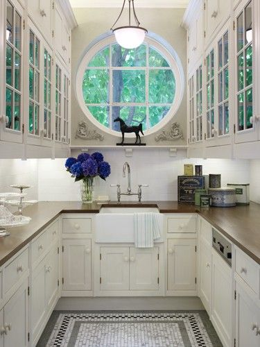 Fabulous...window, glass front cabinet, use of space, floor tiles..    Content in a Cottage