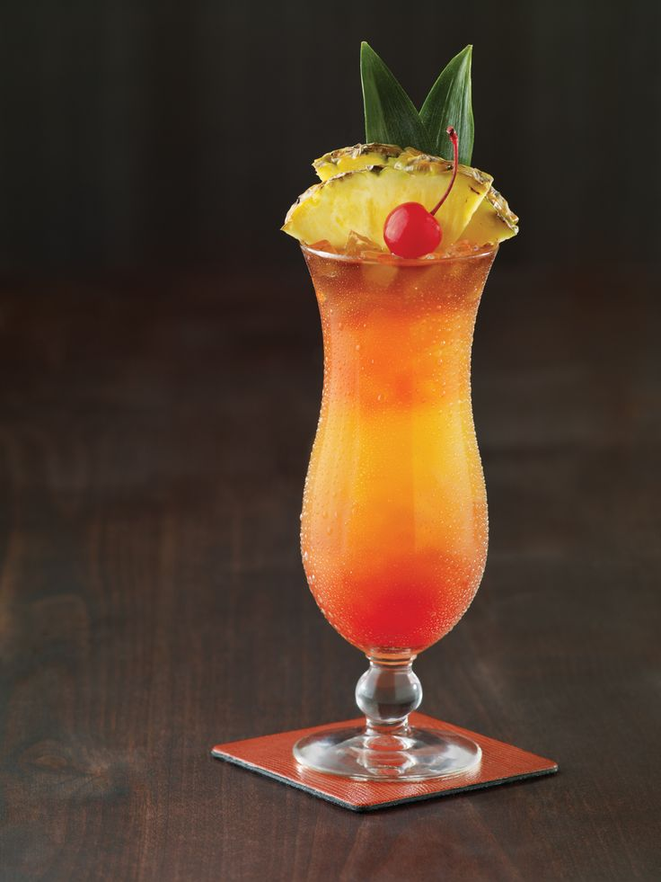 A rum drink contributed by The Bartending School. 2 oz light rum, 1 oz triple sec, 1 tsp powdered sugar, 1 tbsp almond syrup (orgeat), 1 tbsp grenadine, 1 tbsp lime juice