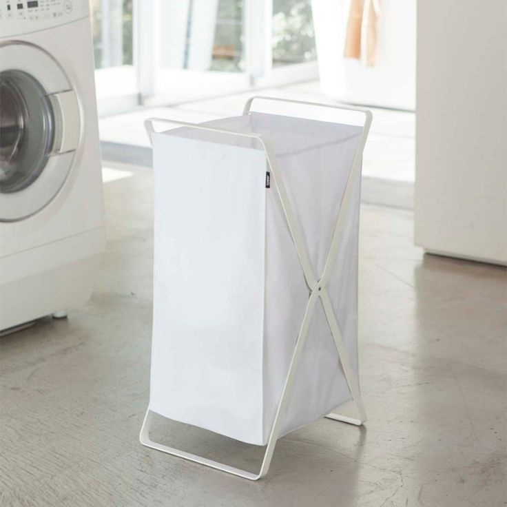 This handy Laundry Basket by Yamazaki can hold a lot of clothes, and can fold up when it comes time to do the laundry. It is lightweight, easy to move around, and in a simple, stylish fashion. Modern style is easy to fold up and pick up to do laundry. It can hold up to 45 L worth of clothes. Made of steel and polyester, designed in Japan.