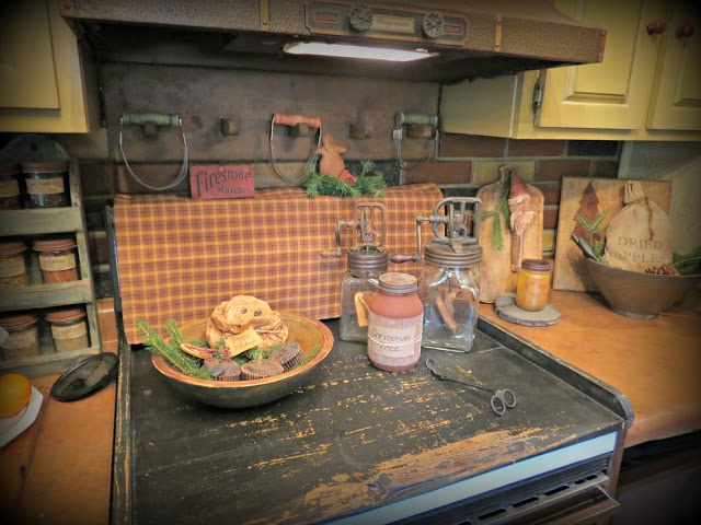 noodle board for the stove and homespun towel hanging over the control panel..