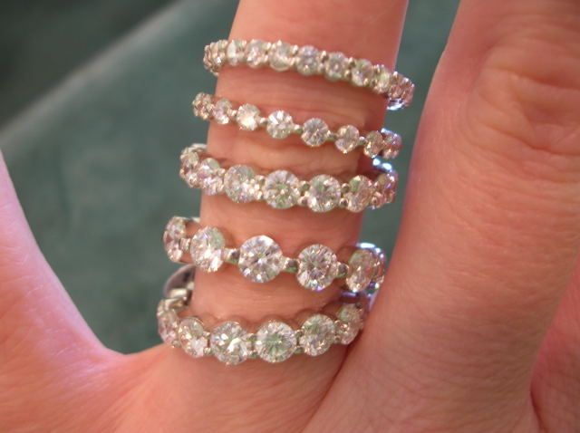 Going to have my diamonds placed into rings like this!!! I want to make 3 stackable rings!!!
