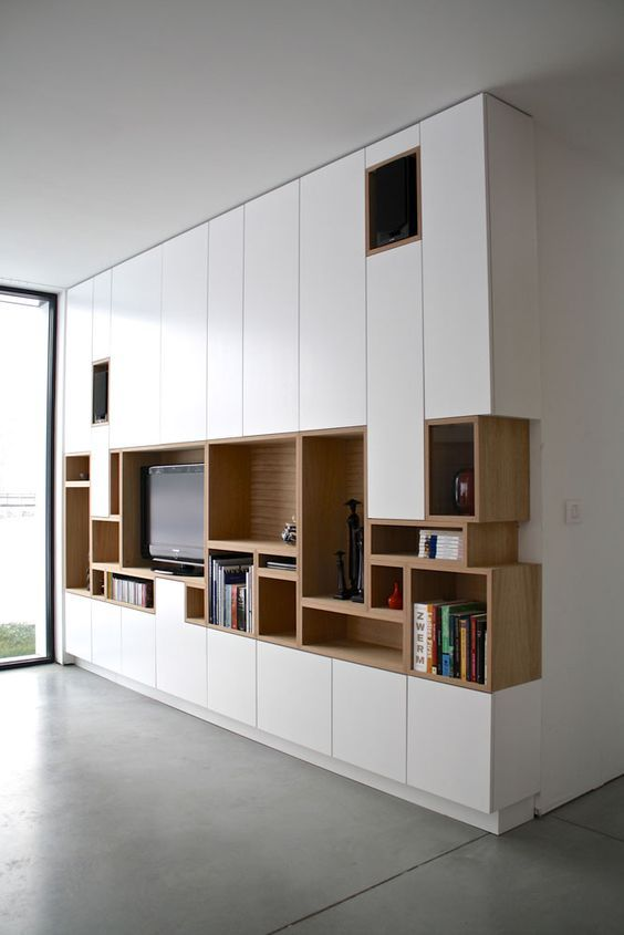 White built-in unit with open shelves, cupboards and space for TV http://www.in-form-design.com