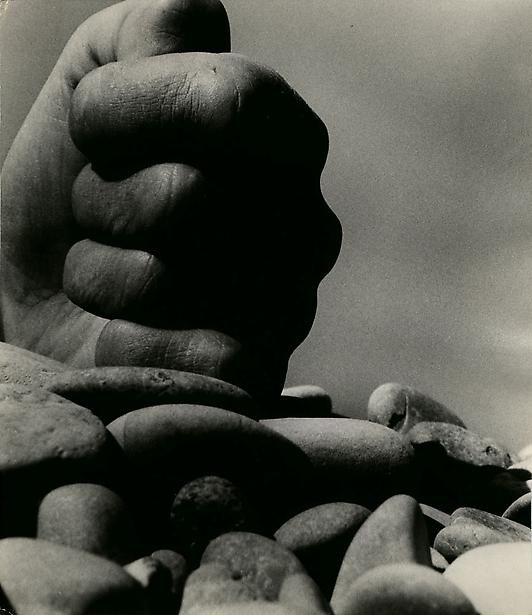 Bill Brandt - Clenched Hand on Rocks