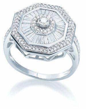 Elégance rétro de H.Gringoire    On la croirait venue d'un autre temps, cette bague en or blanc incrustée de diamants. Délicate et majestueuse, elle vous fera craquer.        * Prix : 1 650 euros      * Où l'acheter : www.h-gringoire.fr