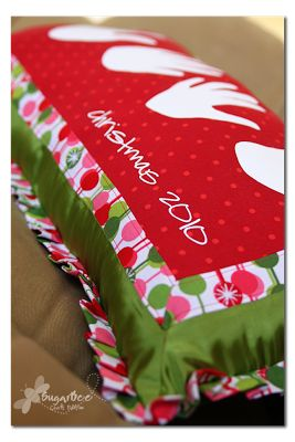 how to make a custom Handprint Holiday Pillow - i love that the kiddos can measure their hands against this every year to see how they're grown - fun tradition!  Sugar Bee Crafts