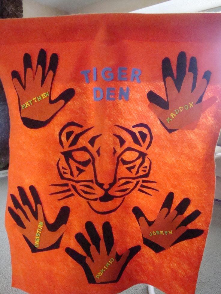 Tiger Den Flag idea. Adult hand behind the child handprint. Working hand in hand. :)