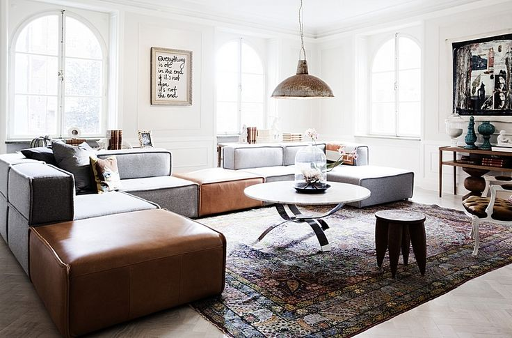 Oversized lounge in contrasting colours and an antiqued rug. Perfection.