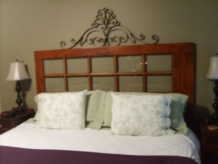 French door repurposed as a headboard... the wheels are spinning... ;-)
