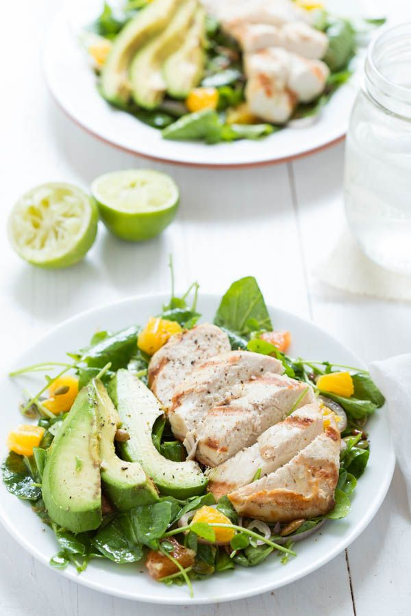 Grilled Tequila Chicken with Orange, Avocado and Pepita Salad - chicken is marinated in a tequila-lime sauce, grilled and then served over a bed of watercress with oranges, pepitas, and grilled avocado!