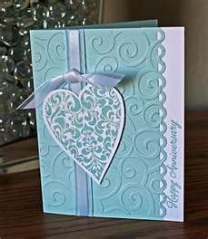 blue anniversary. Like the simple clean look. I think I'll turn the card horizontally so the sentiment is easier to read. Yes, it could be quilled.