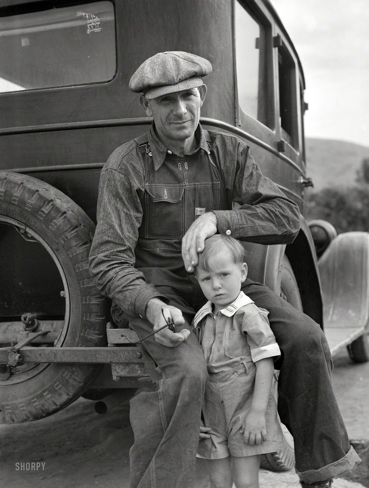 "November 1936. ""Drought refugee from Polk, Missouri. Awaiting the opening of orange picking season at Porterville, California."" Photo by Dorothea Lange for the Resettlement Administration."