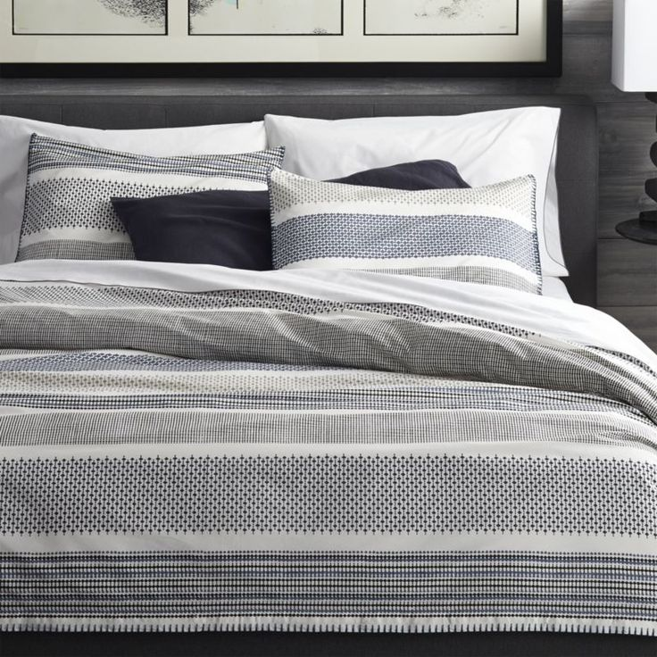 Upon closer look, contemporary stripes of tonal blues reveal intricate traditional Indian filigree patterns.  Jaipur-based designer Manish Tibrewal's geometric design is first hand-carved in a wood printing block, screenprinted onto crisp white percale, then hand-embroidered at the edge by artisans with beautiful precision.  Bed pillows and duvet inserts also available.