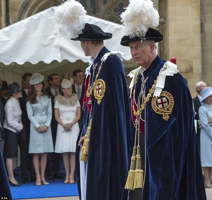 William looks over at his wife who gives him a big smile as he passes during Order of the Garter ceremony
