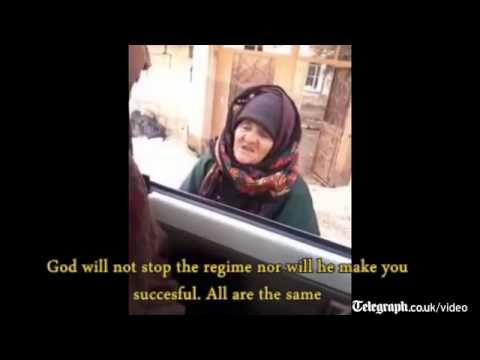 Elderly woman challenges Islamic State militants, calling them 'devils' - YouTube