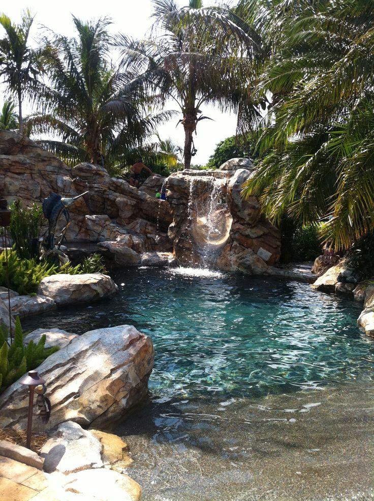 Lagoon backyard pool with beach entry, man-made boulders, rocks and waterfall, and much more...
