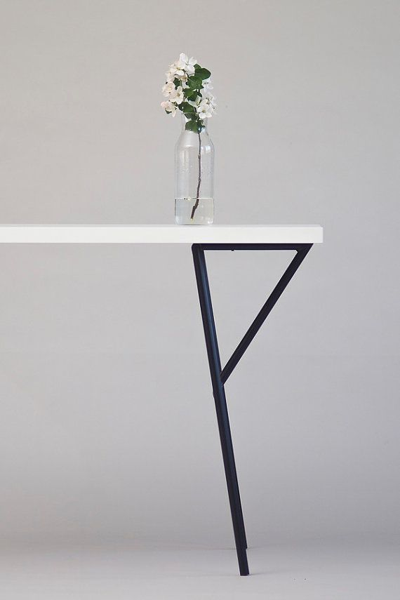 Minimalist modern metal table legs. All crafted by hand. Powder coated in matte black. 75 cm tall 59 cm wide 30 cm deep Tube 20 mm Mountable with 3