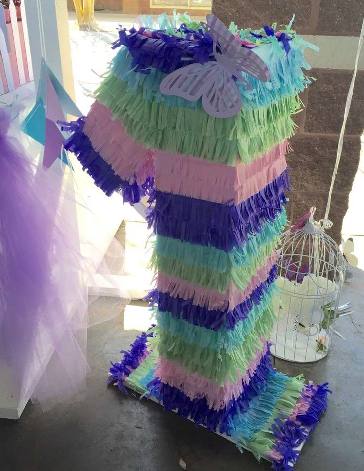 Colorful pinata at a butterfly birthday party! See more party ideas at CatchMyParty.com!
