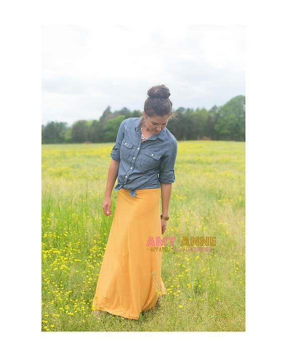 This skirt Is So comfy!! It is a must have for any wardrobe. It is a staple skirt in a staple color. You will not regret you purchased this skirt! This skirt is available in any Womens Sizes Ranging from S-XL Fabric: Poly/Spandex Fabric lays and drapes very well, and is wrinkle