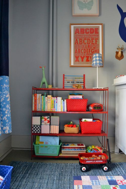 I love this baby nursery. The classic colors, vintage toys and letterpress prints. I'm in love.