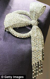 Elizabeth Taylor Estate. An Art Deco Diamond Bow Brooch. Sold at auction